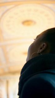 Thoko admiring the church ceilings
